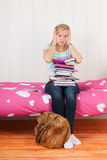 Too many homework. Fourteen year old girl with many schoolbooks and too many homework Stock Image