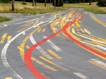 Too Many Lines. An apparent dumping ground for extra paint or practice area for novice road line painters, this road is quite colorful Royalty Free Stock Photo