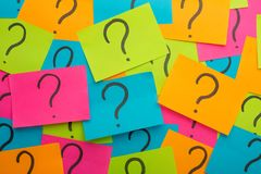 Too Many Questions. Pile of colorful paper notes with question marks. Closeup. Stickers with question marks, forming a big question mark. question mark on the royalty free stock photography