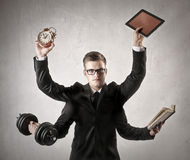 Too many things to do. A businessman has too many things to do Royalty Free Stock Photo