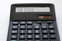 Too much. The calculator with caption Too much on the display Royalty Free Stock Photography