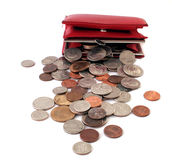 Too Much change. Coins pouring out of a red female wallet over a white background Royalty Free Stock Photo