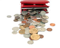 Too much change. American coins pouring out of a red female wallet Royalty Free Stock Photography