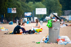 Too much garbage on the metalic trash on the beach Royalty Free Stock Images