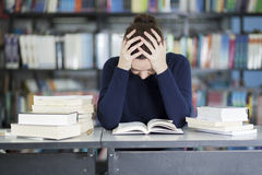 Too much homework. Female college student stressed about her homework Royalty Free Stock Photos