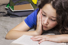 Too much homework for girl Stock Photos