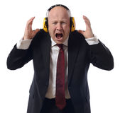 Too much noise. Concept of too much noise man in suit isolated on white stock image