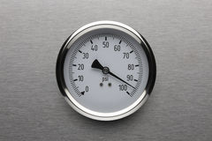 Too much pressure. Pressure gauge shot on stainless steel background Royalty Free Stock Image