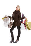 Too much shopping. Young blond teenage girl with loads of bags Stock Images