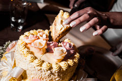 Too much sugar. Detail of hands cutting big cake Royalty Free Stock Photos