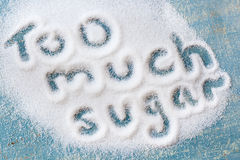 Too Much Sugar. The words too much sugar written in sugar grains.  Overhead view Stock Photography