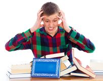 Too Much to Learn. Student lost with his studies Stock Photos