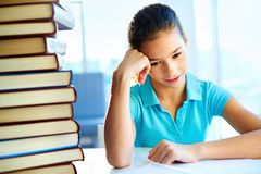 Too much to learn. School pupil being frustrated with the amount of books to read royalty free stock image