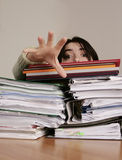Too much work. Office worker with too many files asking for help Stock Photos