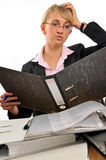 Too much work. Young business woman overloaded with work Royalty Free Stock Photo