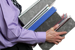 Too much work. Businessman carrying a stack of files, concept for overwork, busy or multi-tasking Royalty Free Stock Image