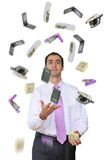 Too much work!. Businessman juggling too many office tools, some falling. Isolated on white stock photo