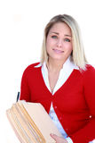 Too Much Work. Pretty young blond office worker holding a large stack of files with a facial expression that says help Stock Photo