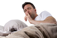Too Noisy to Sleep. Man unable to sleep because of loud noise Royalty Free Stock Images