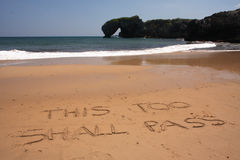 This too shall pass. The ultimate philosophical lesson on a sunny summertime beach Royalty Free Stock Photography