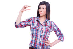 It is too small. Beautiful young woman gesturing small size and expressing negativity while standing isolated on white stock photos