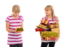 Too small gift. Girl with lots of gifts looking at another girl sarcastically having only a small gift and disappointed. Isolated on white Stock Photos
