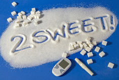 TOO SWEET written with  sugar. Sugar on a blue background with warning message 2 SWEET written on it. Health concept. Diabetes hazard Stock Photography