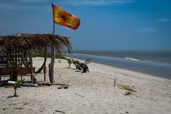 Shady Refuge on a hot White Sand Beach stock photos