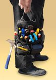 Tool bag. Maintenance engineer holding tool bag isolated with clipping path stock image