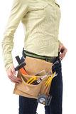Tool bag. Woman with tool bag and a lot of equipment royalty free stock photos