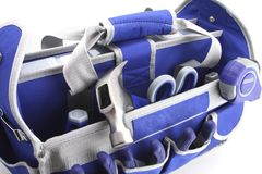 Tool Bag. Blue and gray tool bad hammer tape measure stock images