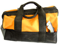 Tool Bag. Orange Tool Bag with an Electrician Knife in it Pocket in white Background Royalty Free Stock Photography