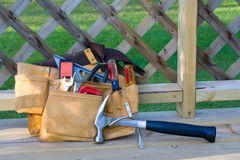 Tool belt. A tool belt sits on a porch at the end of a long day of work royalty free stock images