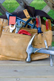 Tool belt. A tool belt sits on a porch at the end of a long day of work royalty free stock photos