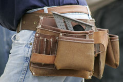 Tool Belt. Close view of a tool belt on a construction worker stock image