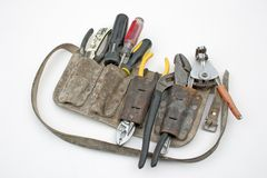 Tool belt. A tradesman's tool belt loaded with tools Stock Images