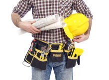 Tool belt. Carpenter wearing a tool belt and holding a hardhat and blueprints, white background stock photography