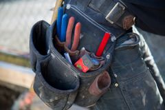 Tool belt construction worker closeup background stock images