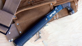 Tool belt with hammer. Leather tool belt with nails and hammer Royalty Free Stock Photography