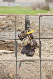 Tool belt. A tool belt hanging on girders at a construction site Royalty Free Stock Image