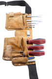 Tool belt with screwdriver and spanner Stock Images