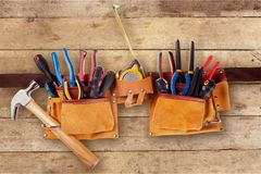 Tool belt. Work tool hammer repairman leather nail pliers royalty free stock photography