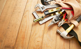 Tool belt with tools. On wood planks with copy space stock photography