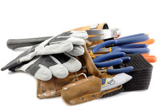 Tool belt with wrench and gloves. Close up shot of tool belt with wrench and gloves Stock Image