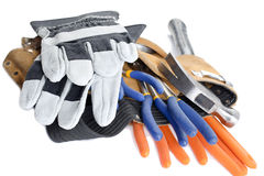 Tool belt with wrench hammer and hand gloves. Close up shot of a tool belt with wrench hammer and hand gloves Royalty Free Stock Images