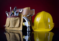 Tool belt and helmet Royalty Free Stock Photo