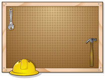 Tool Bench Peg Board. A pegboard background for a tool bench. Blank for hanging notes and signs Stock Photos