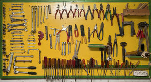 Tool board. Great variety of different types of tools exposed on a big yellow board Royalty Free Stock Image