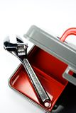 Tool box with adjustable wrench. Clean plastic tool box and an adjustable wrench isolated on white Stock Images