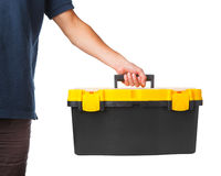 Tool box in hand. Isolated on white Royalty Free Stock Photo